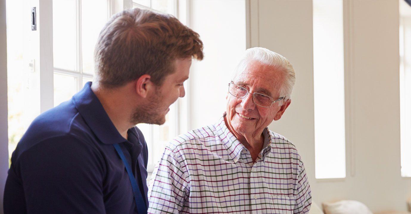 A carer talking to a gentleman