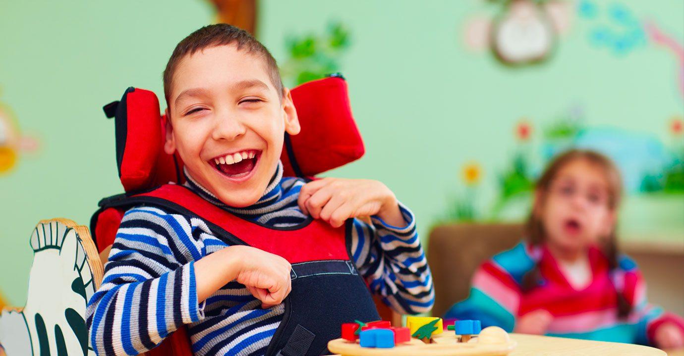 A boy smiling at the camera