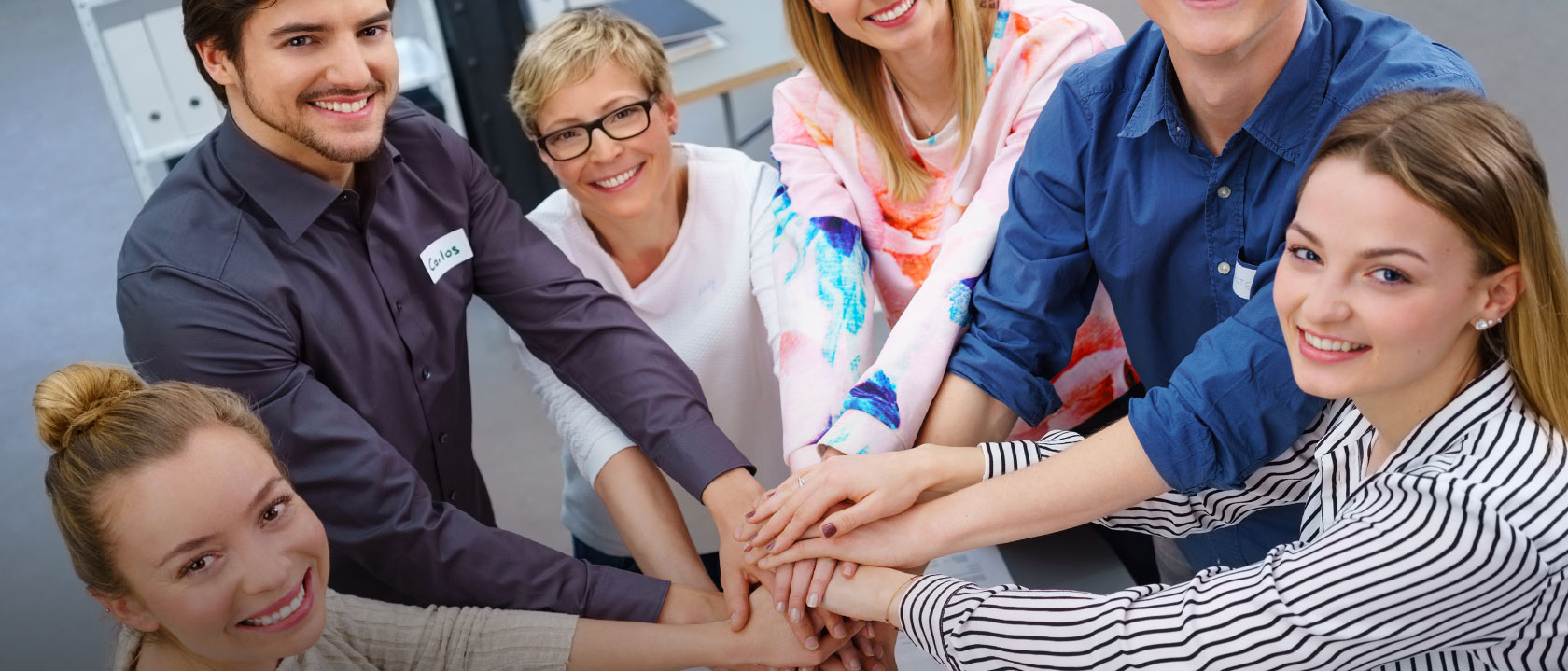 Group of people coming together in professional environment