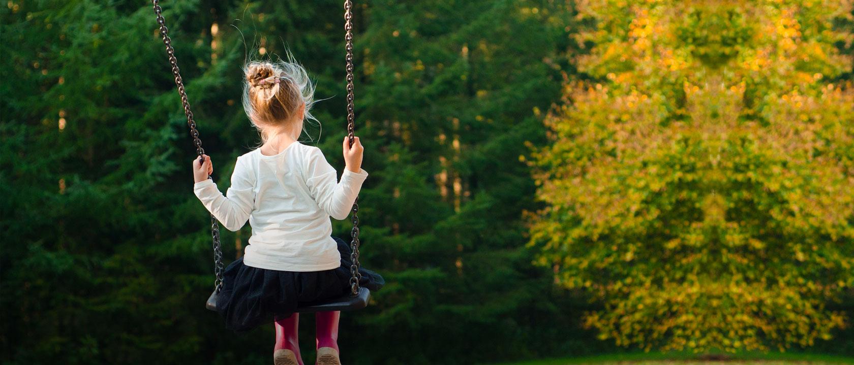 A girl enjoying playground equipment