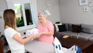 Two ladies ironing