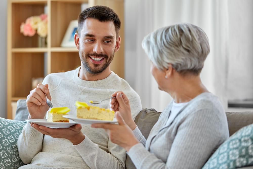 Son and mother enjoying cake