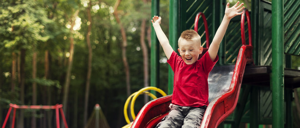 Young boy on a slide