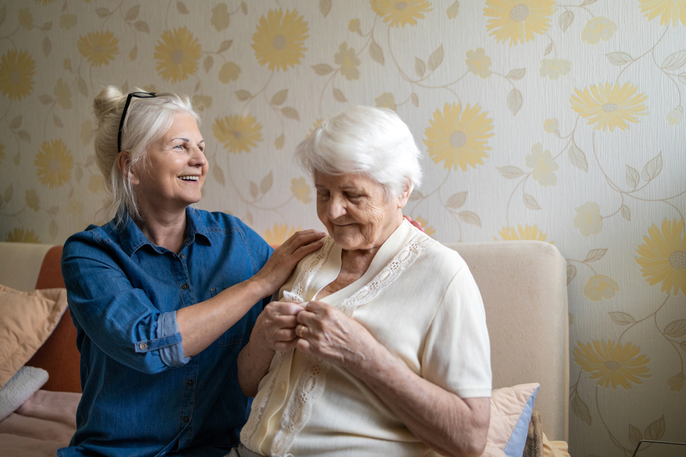 Carer helping elderly mother