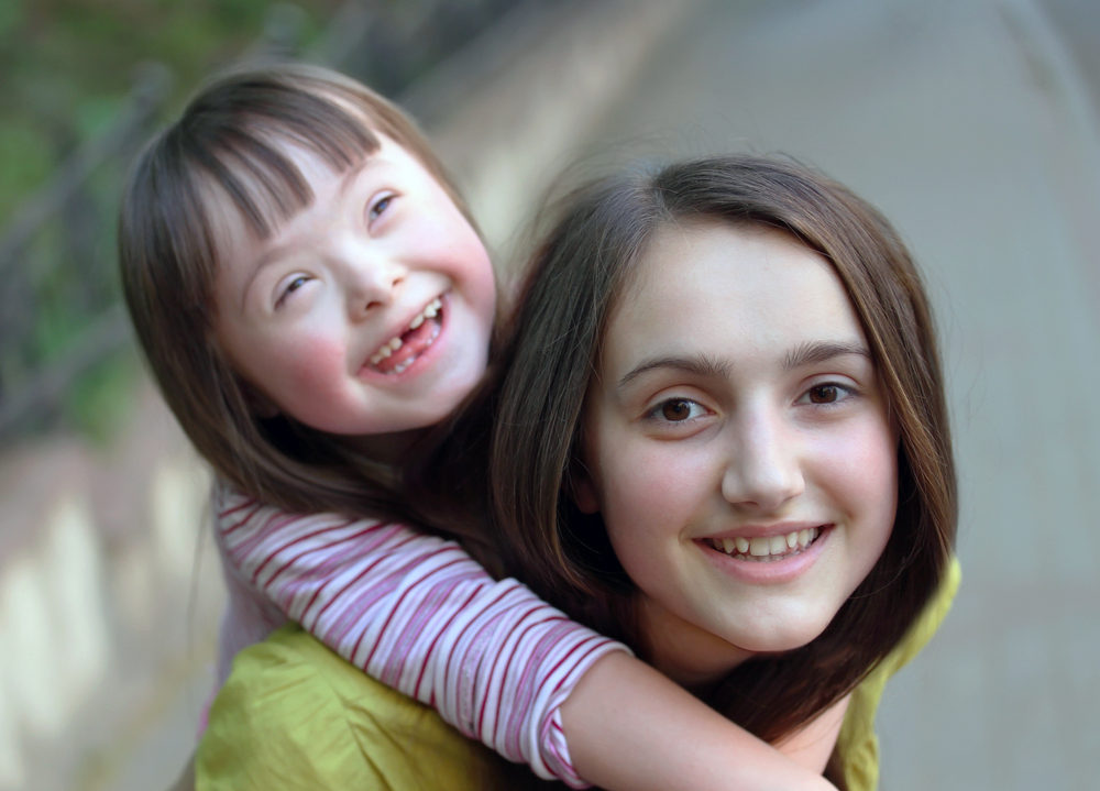 Young carer with sister
