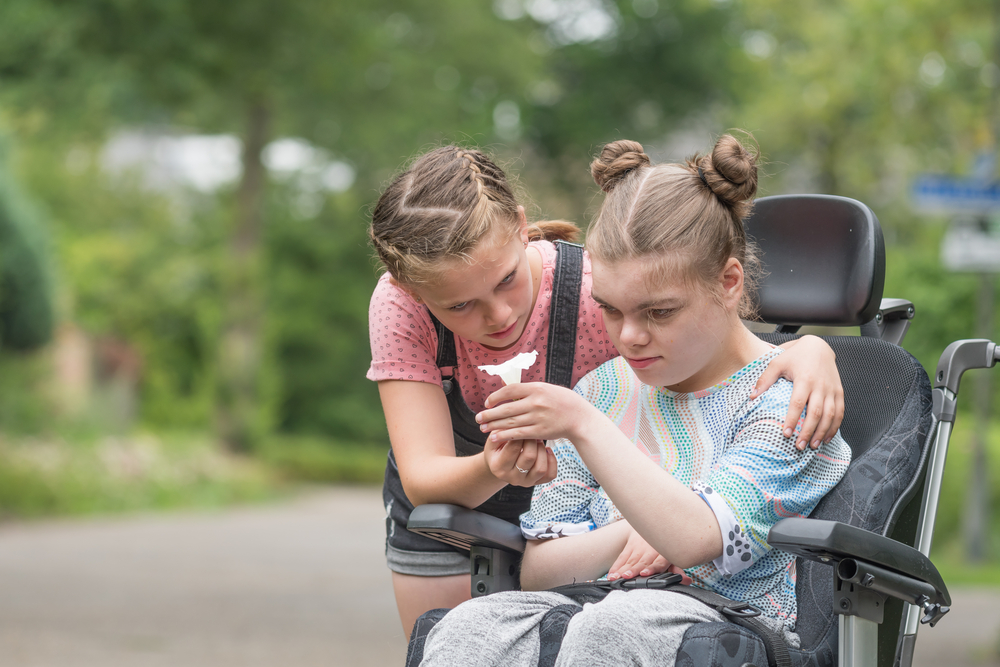 Image of young carer supporting her sister