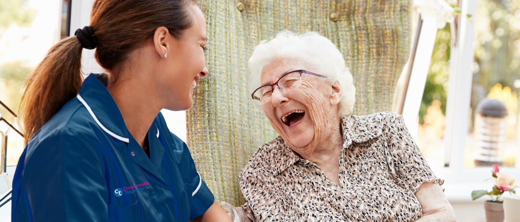 Support worker caring for elderly woman